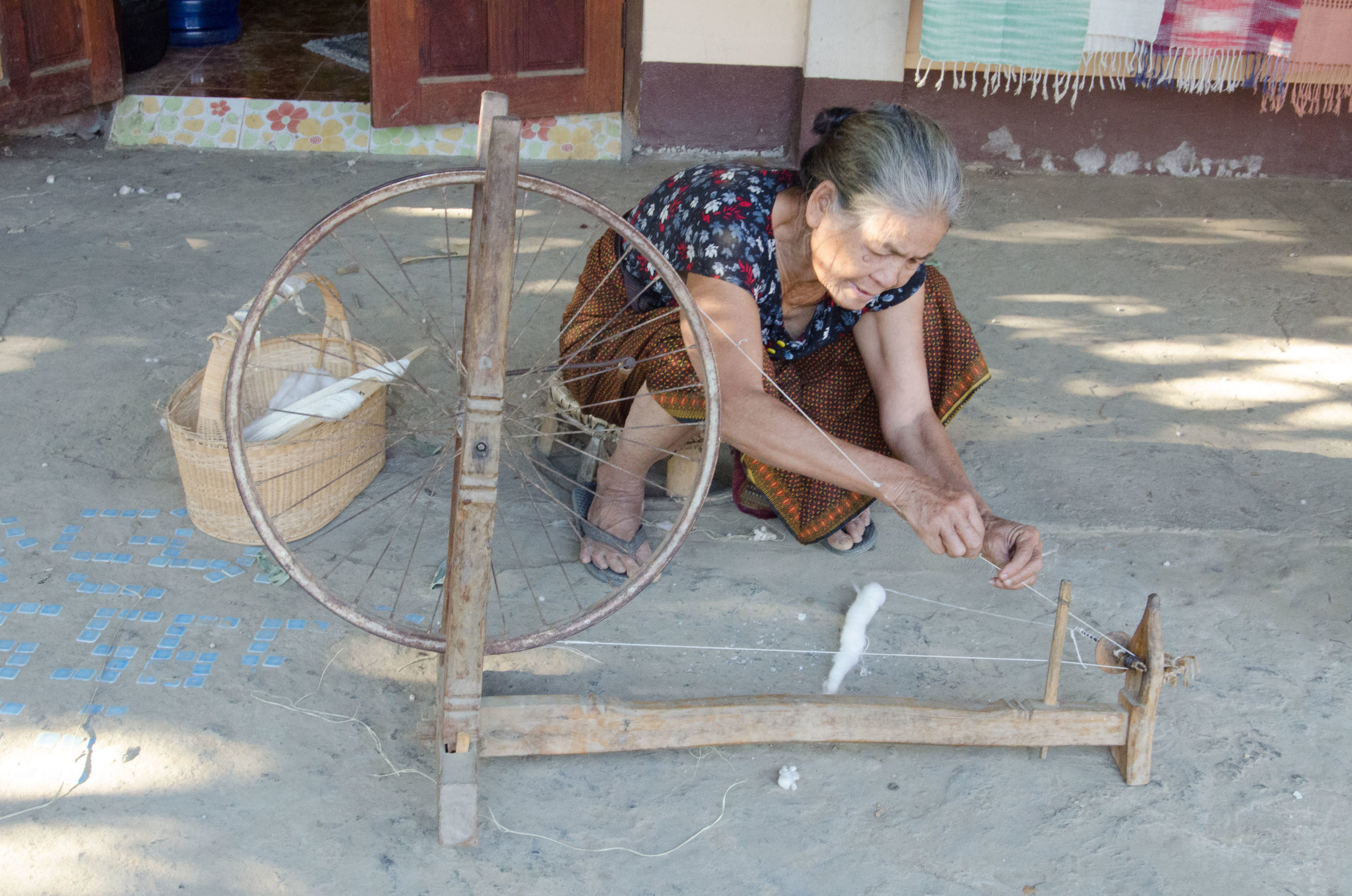 Lowlands ethnic minority village lady spinning ctoton, Luang Prabang, Laos, 1 Dec 2017.jpg