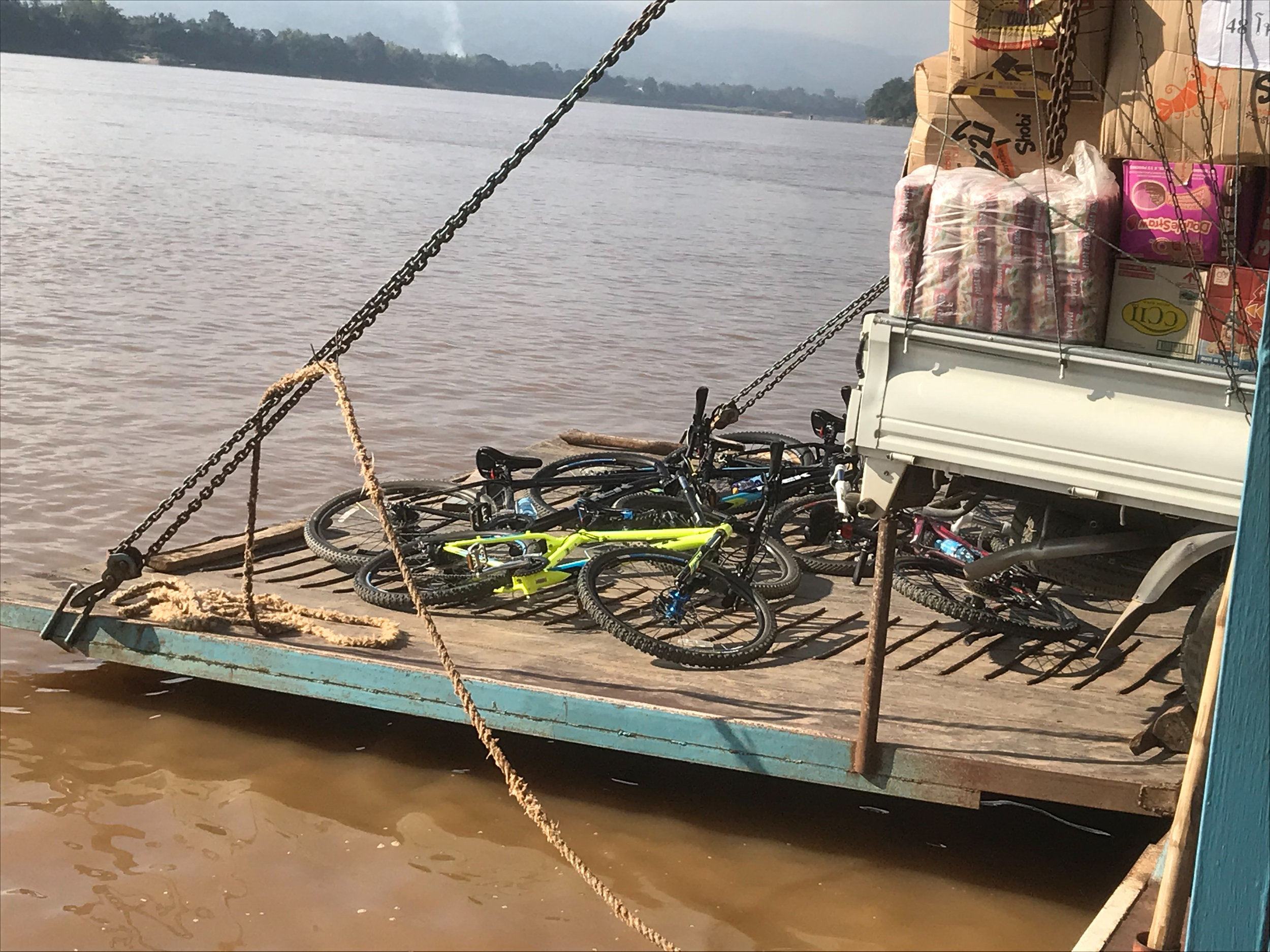 Our bicycles on the ferry across the Mekong, Luang Prabang, 3 Dec 2017.jpg