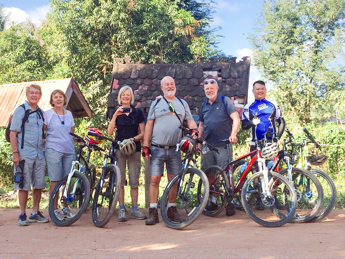 Our group of cyclists with guide Pheng, Ban Na Kham, 3 Dec 2017.jpg