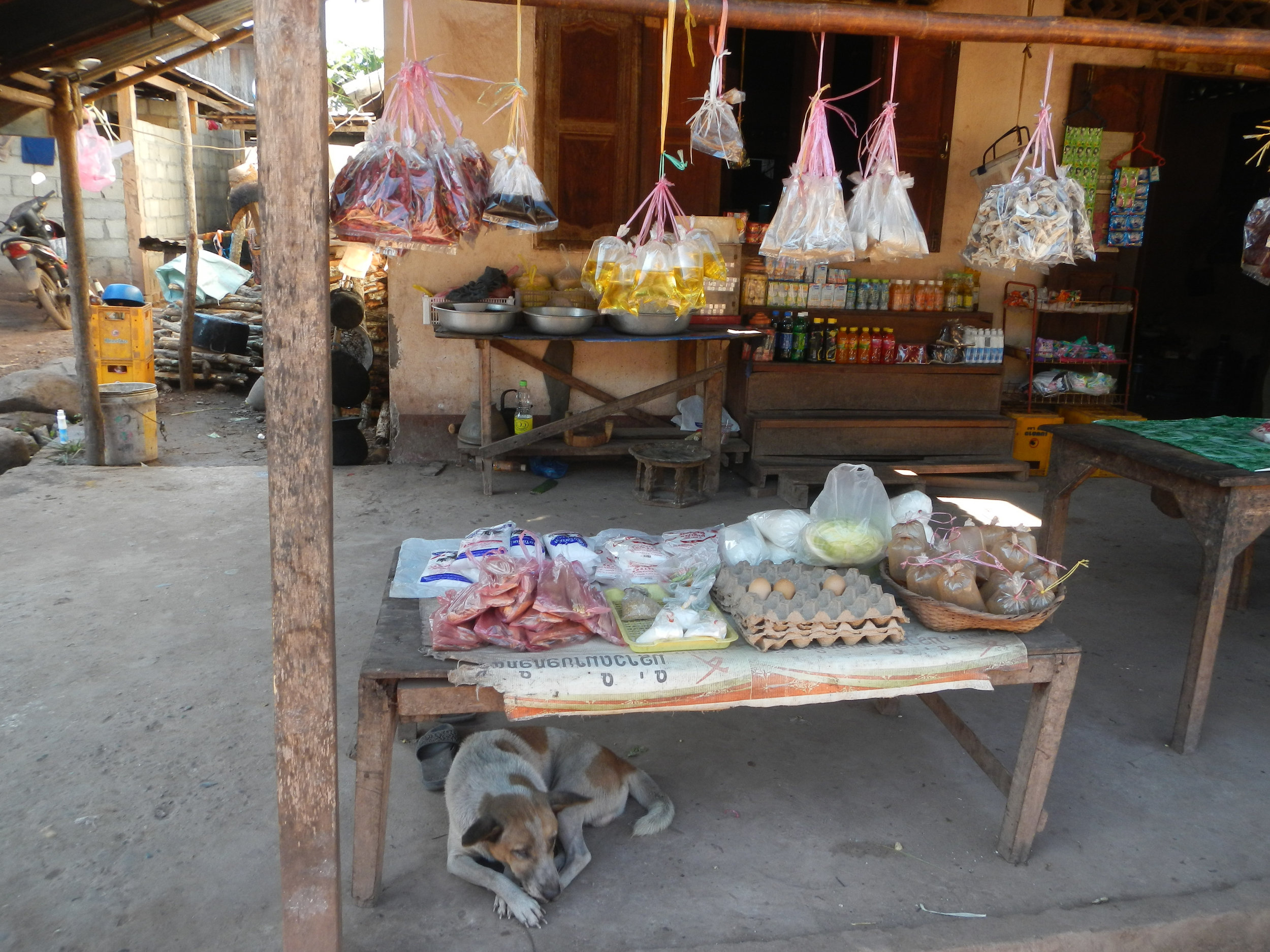 Local shop (with pig oil), Ban Na Kham, 3 Dec 2017.jpg