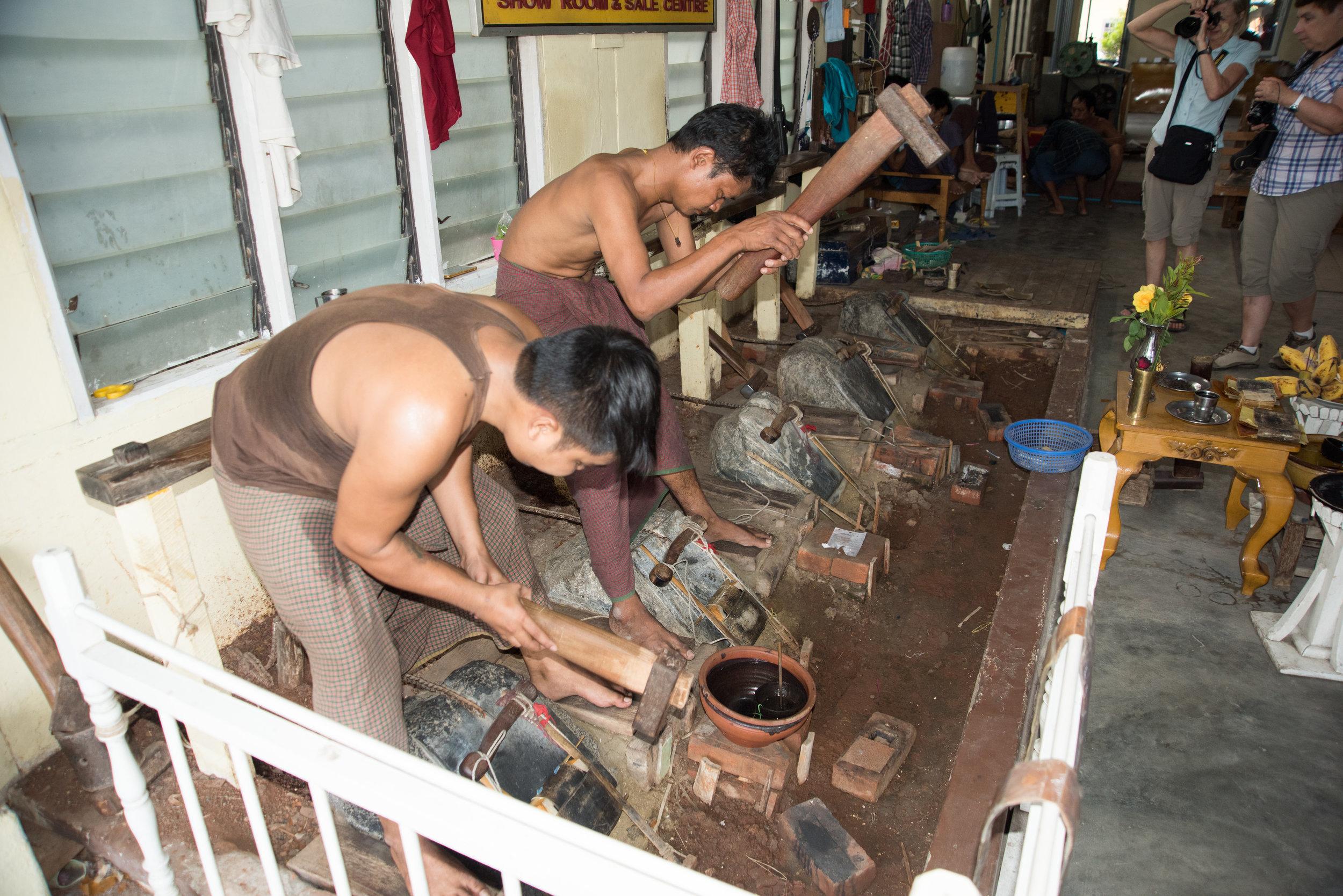 Pounding gold leaf, King Galon Gold Leaf Workshop, Mandalay, Myanmar