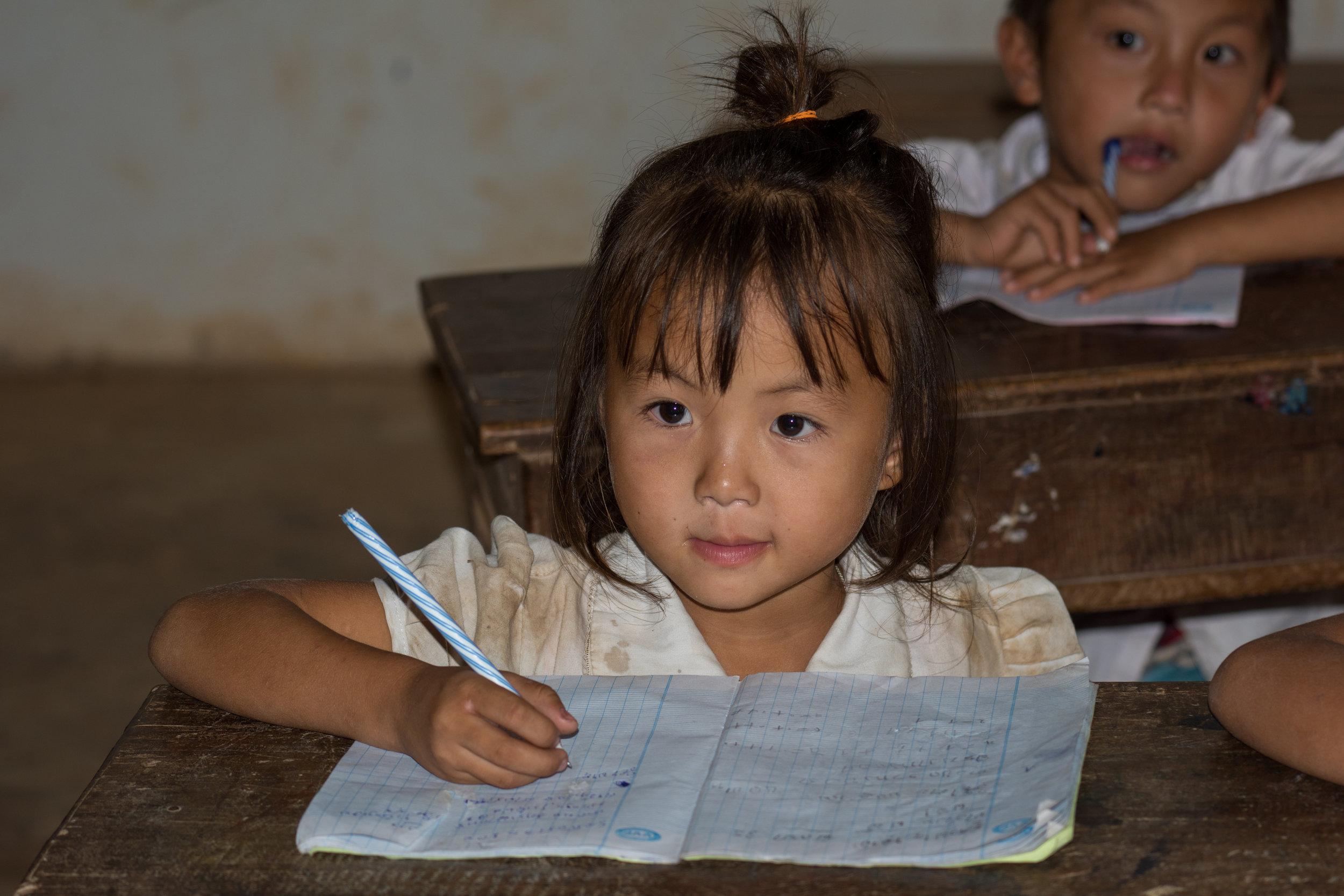 School child, Phone Ngeun, Vang Vieng, Laos
