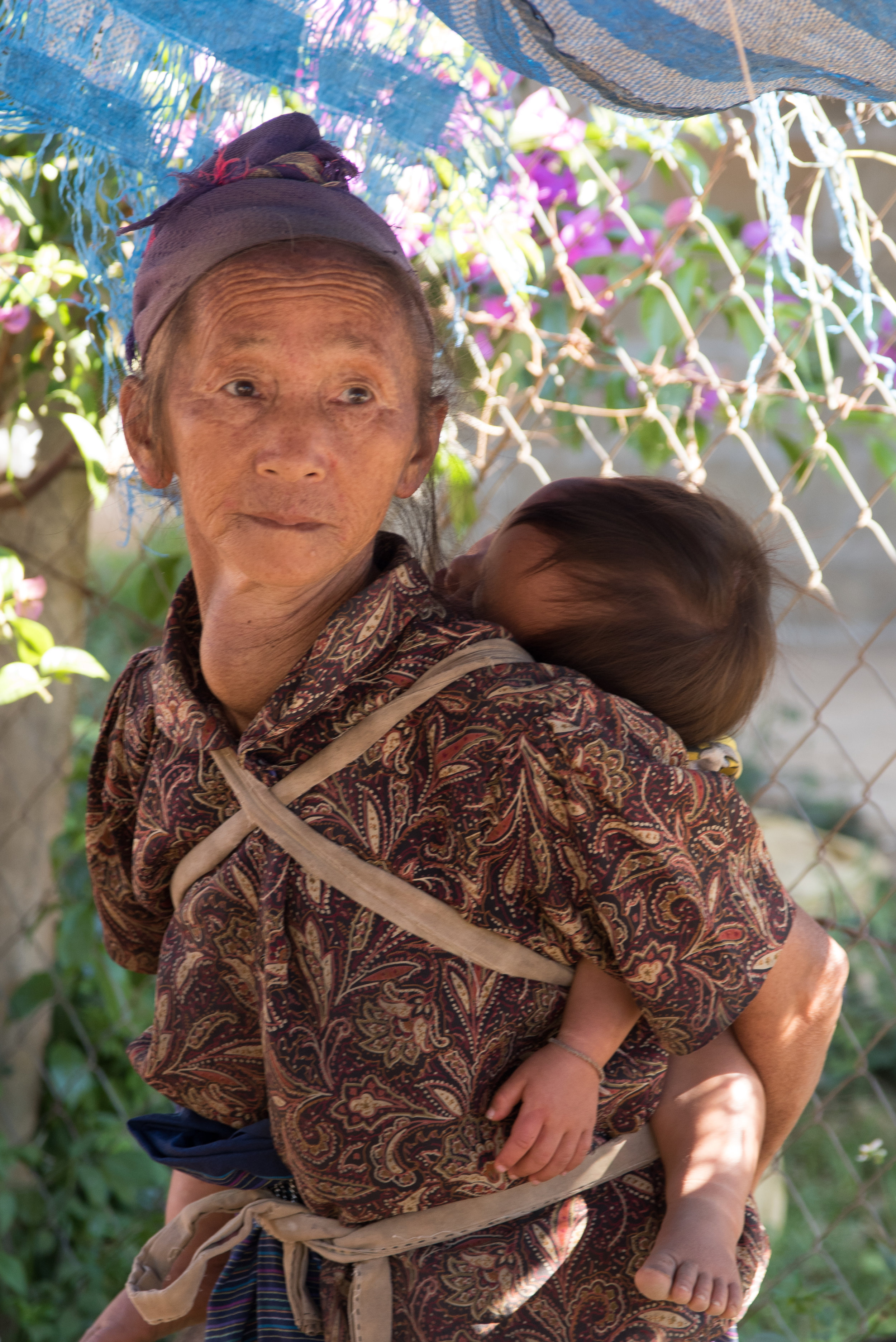 Grandmother and child in village, Ban Phajao, Laos
