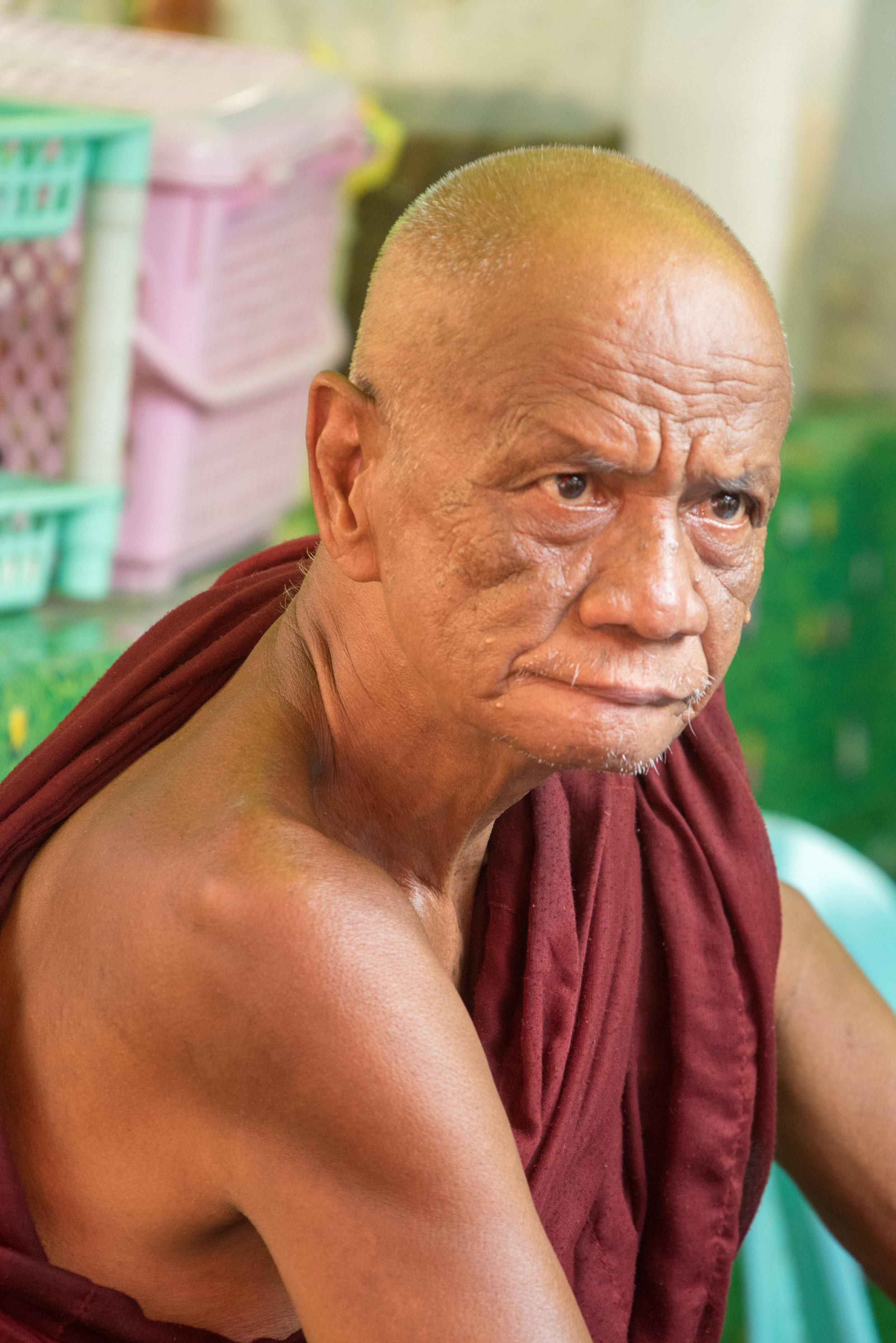 Monk in market, Colonial area, Yangon, Myanmar
