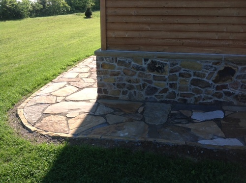 stone pathway around house.jpeg