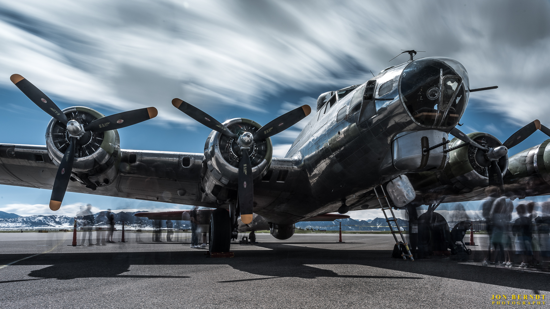 """B-17G """"Madras Maiden"""". Lots of people surrounded the aircraft, so I made some longer exposures that """"ghosted"""" the people and let the afternoon clouds paint the sky. This exposure was about two minutes."""