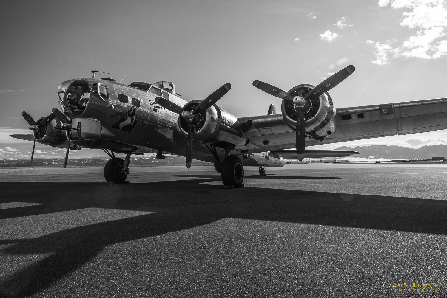 """B-17G """"Madras Maiden"""" lit by the setting sun at Rocky Mountain Metropolitan Airport in Broomfield, Colorado."""