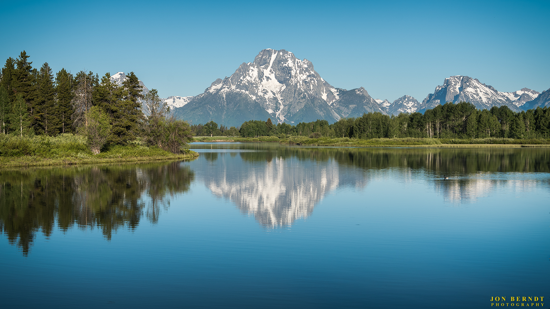 The view of Mount Moran reflecting in the Snake River at Oxbow Bend.   Click here  for information on ordering a print of this photograph.