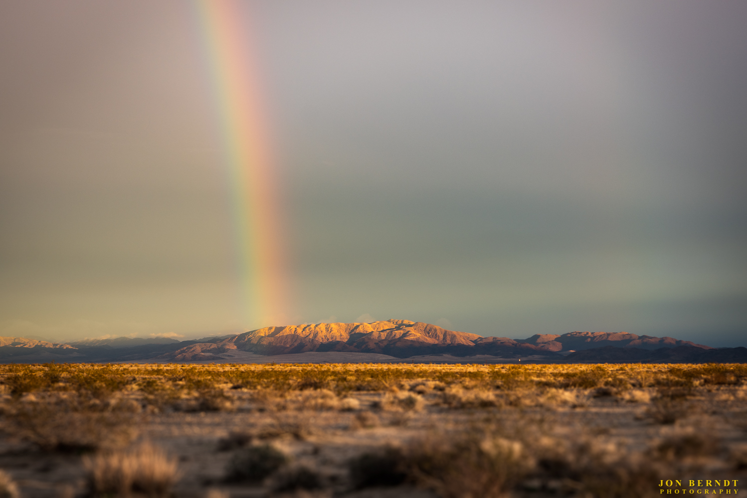 In the evening on the way to   The Palms   restaurant I saw this rainbow. This was taken on the evening of February 18th, 2017 - the same day that began with the photograph at the top of this page with clouds hugging the mountains to the south of Wonder Valley. This rainbow is also seen looking south from near The Palms.