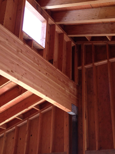 Framing is often one of the best parts of construction. Here in the barn, the wood will remain exposed. North-facing clerestory windows will be operable to vent warm air in the summer.