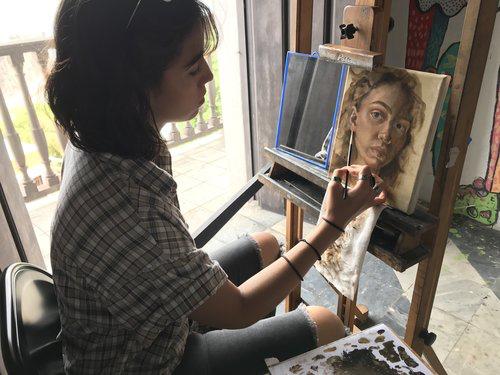Student Daniela Irrizarry working on a self portrait.