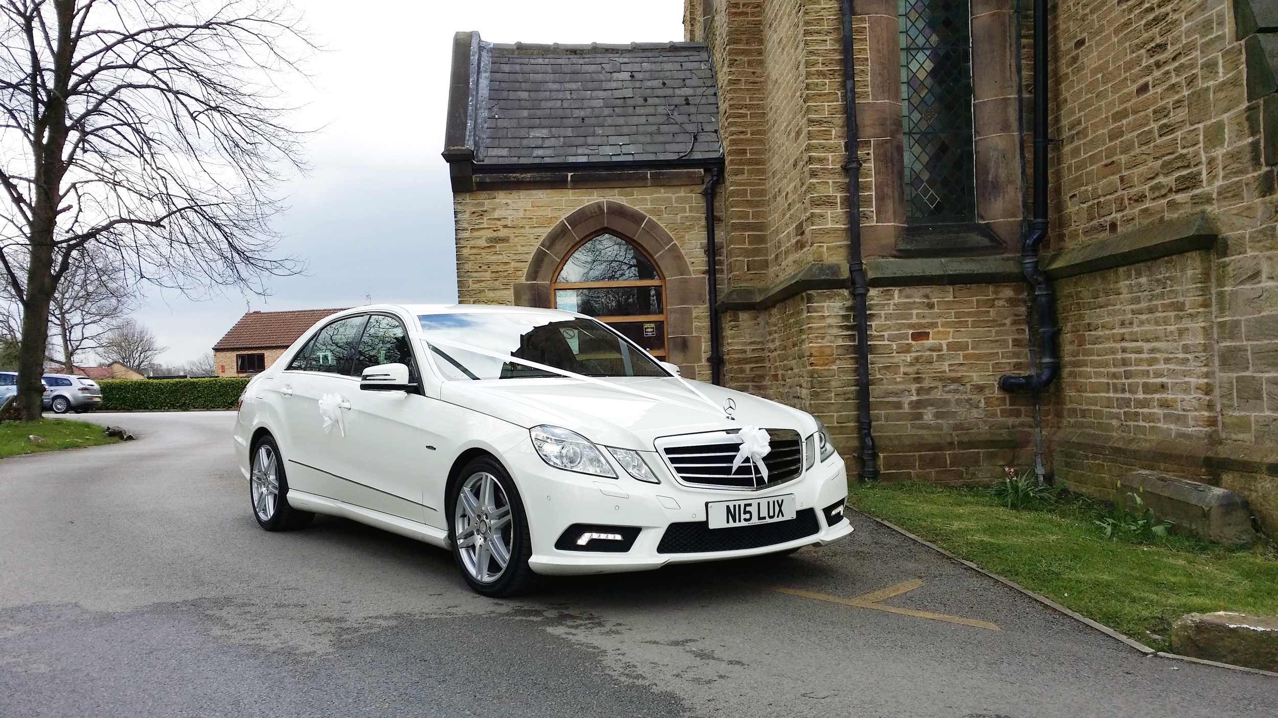 White wedding car at Holy Trinity Church, Thorpe Hesley