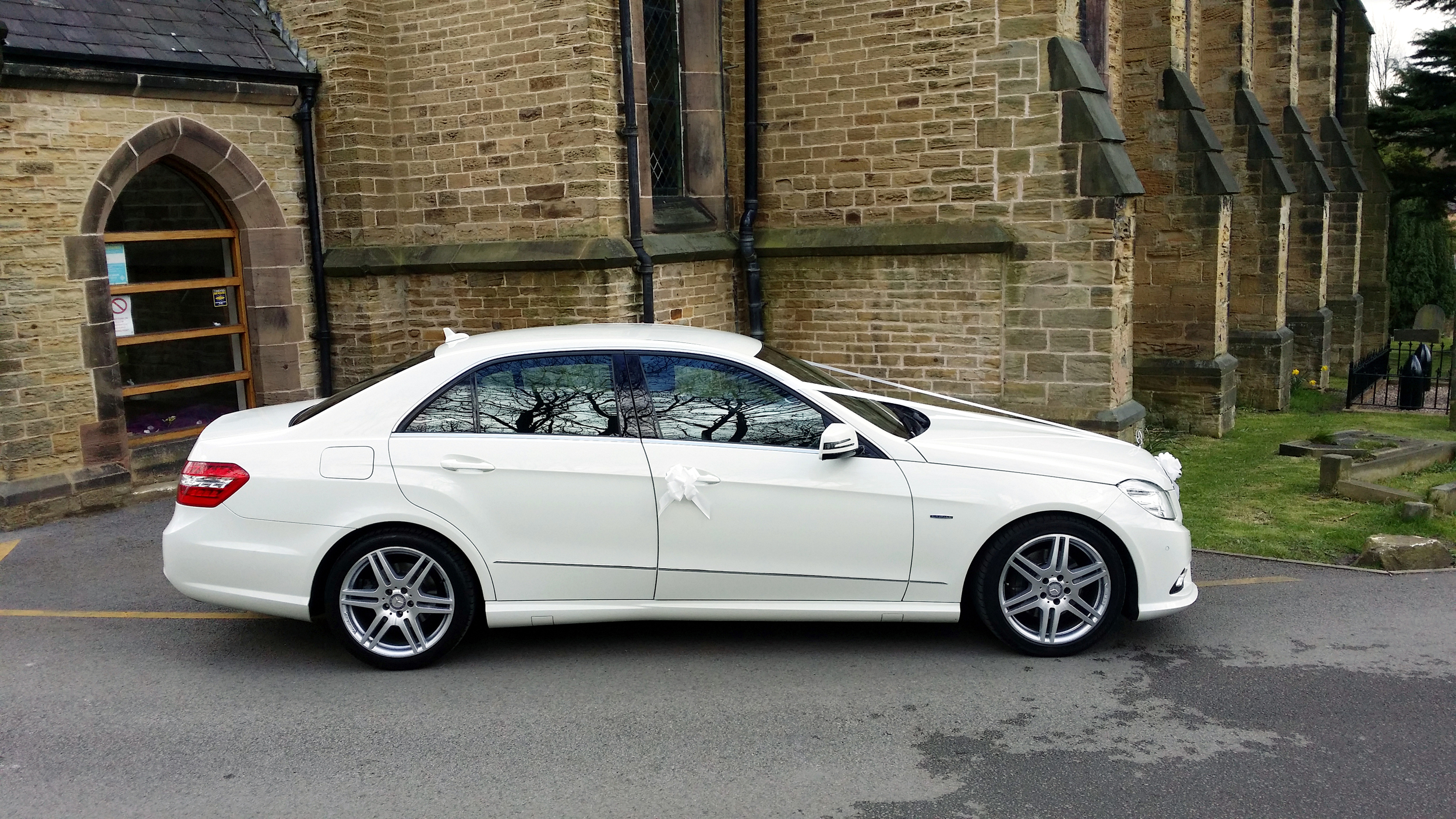 Wedding car at Holy Trinity Church, Thorpe Hesley