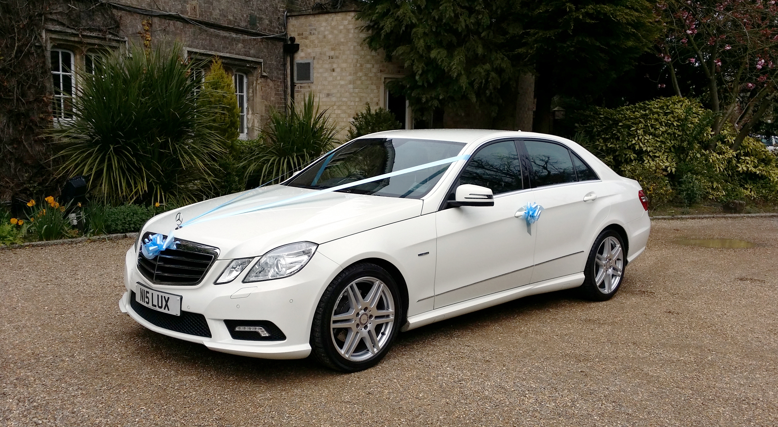 White Mercedes wedding car at the Parsonage Hotel in York, North Yorkshire