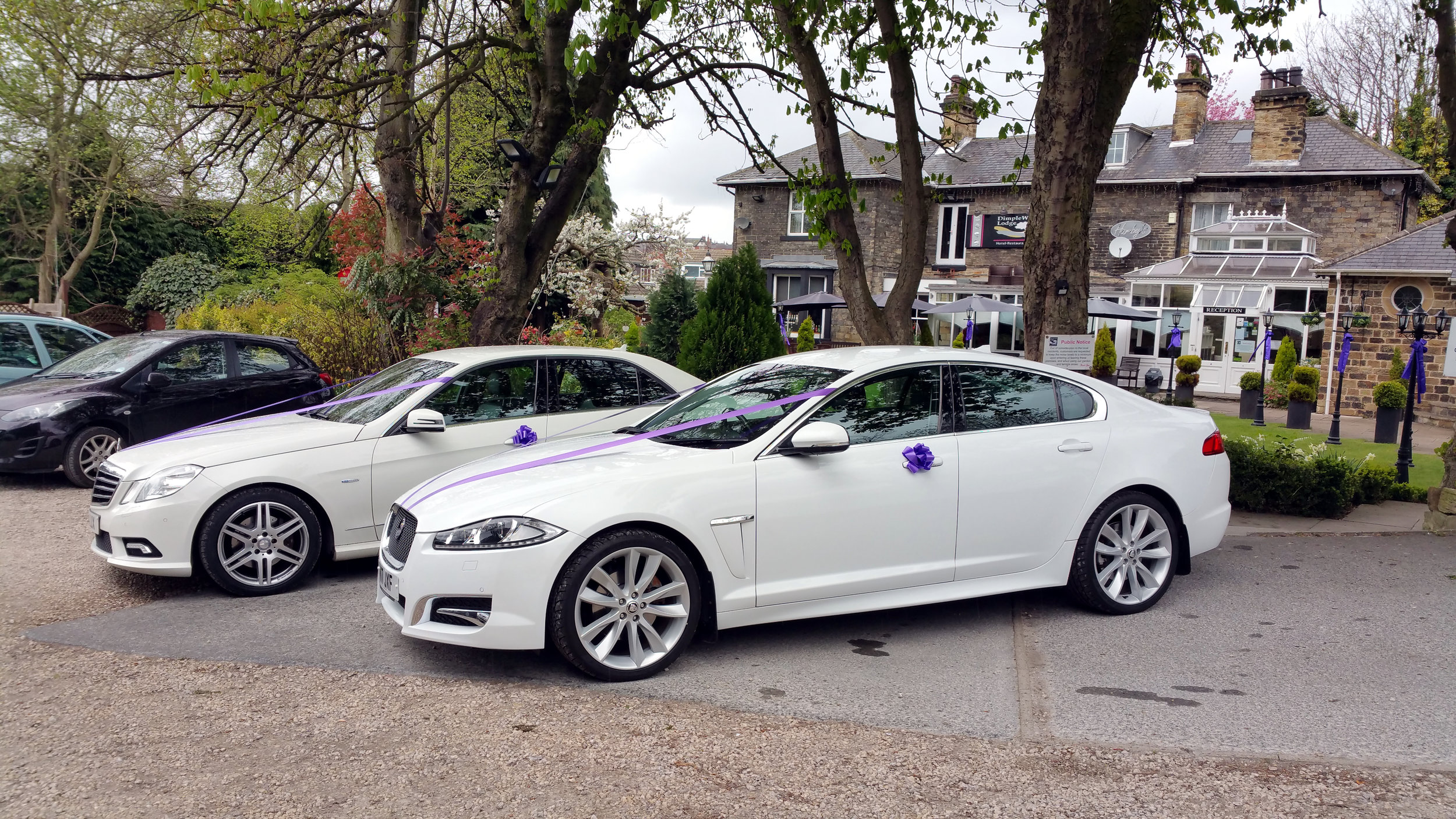 White Mercedes and Jaguar Wedding Cars Yorkshire.jpg