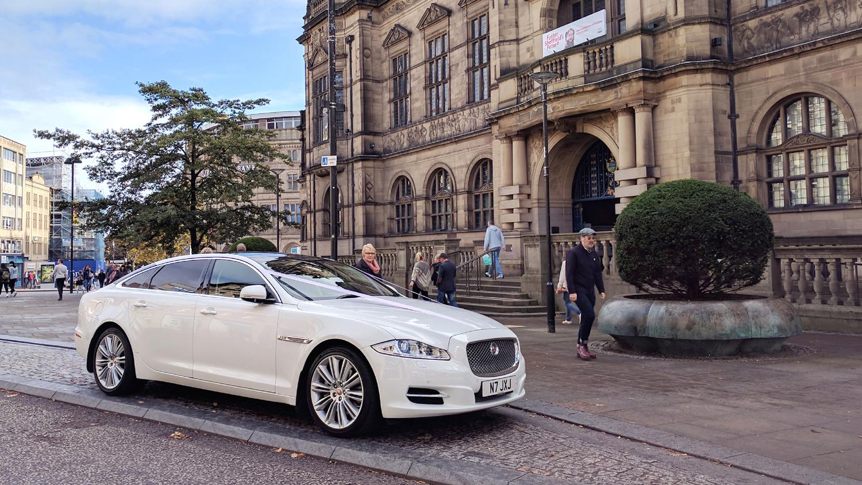 white-modern-jaguar-wedding-car-sheffield-town-hall.jpg
