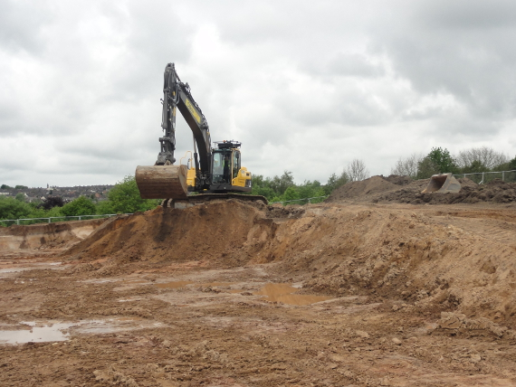 The depth of the 'cut' here allows for this higher quality subsoil material to be layered on top of the mining spoil to create the foundations for a quality sports surface.