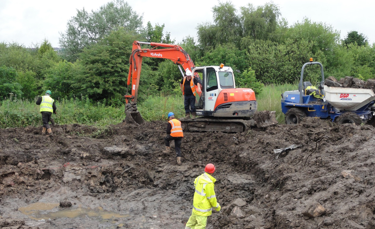 The excavation phase of the pond construction was made more difficult due to buried boulders.