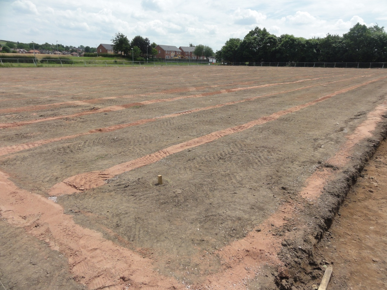 Completed Turfdry Drainage System installation on senior pitch with Hydraway Sportsdrain at 2.5m spacing.