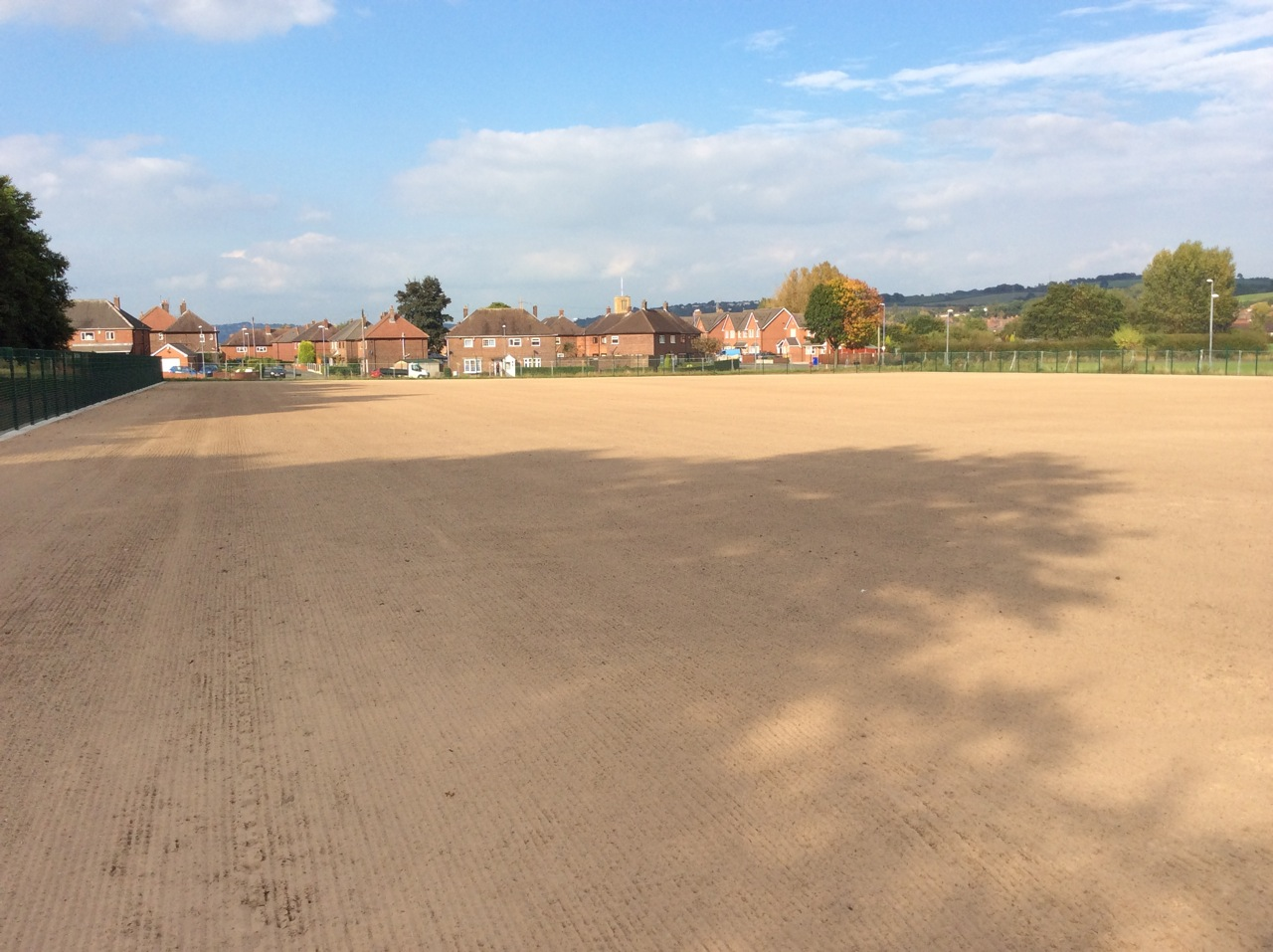 Senior pitch after sand layering and seeding.