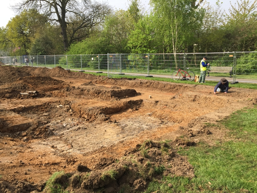 Archiologists work at uncovering and recording remains of WWII bomb shelter