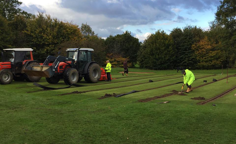 Trenches are cut into the stripped section of the green.