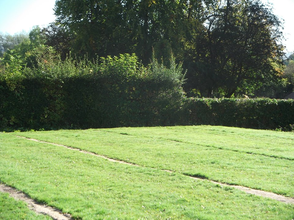 Drain lines, as well as the re-levelled section of the site, were re-seeded following completion of the drainage installation to restore the site.