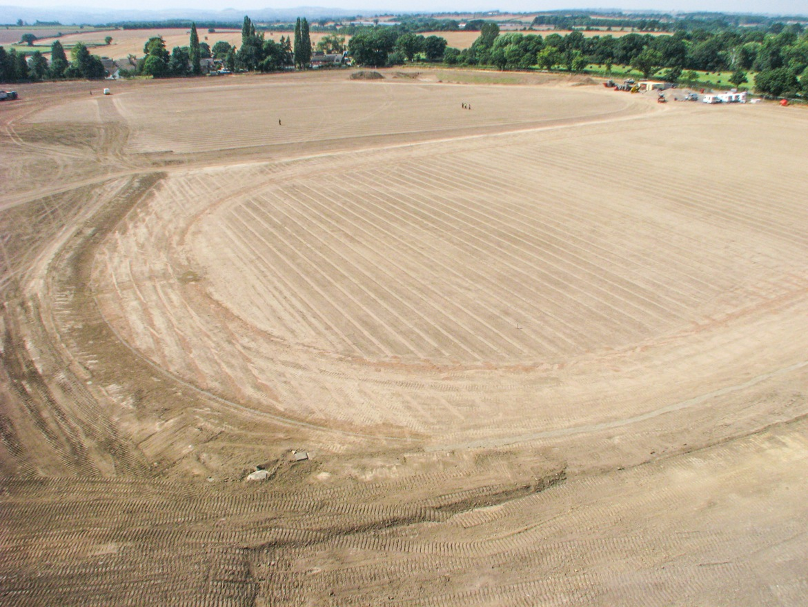 The adult pitch and running track, following drainage installation.