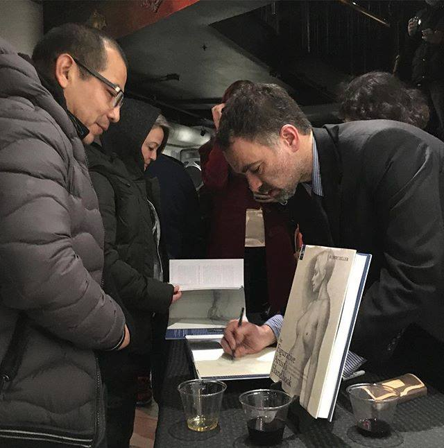 A scene from a book signing at Booth Gallery