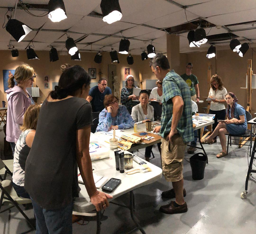 Zeller conducting a workshop at The Teaching Studios of Art® on color theory and mixing oil paint.