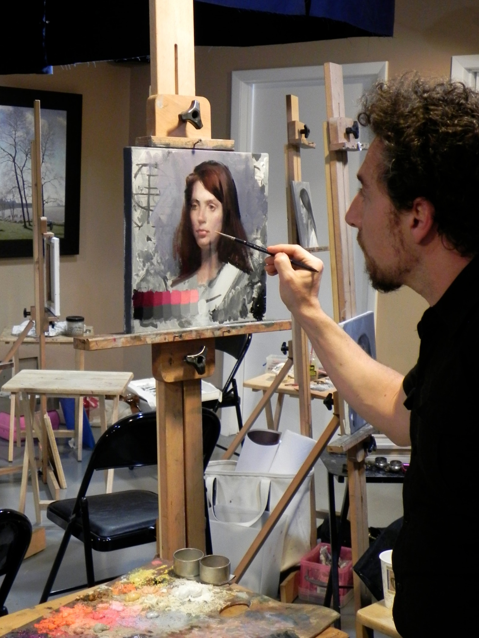 The artist Christopher Pugliese demonstrating how to color a grisaille underpainting, with transparent and opaque glazing.