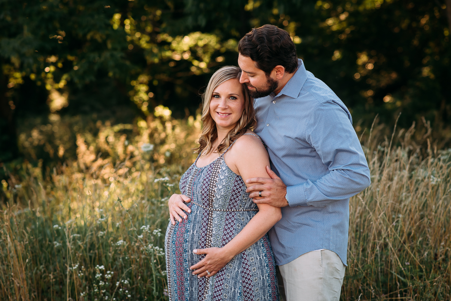 maternity photography pregnant woman with husband tall grasses Baltimore Photographer