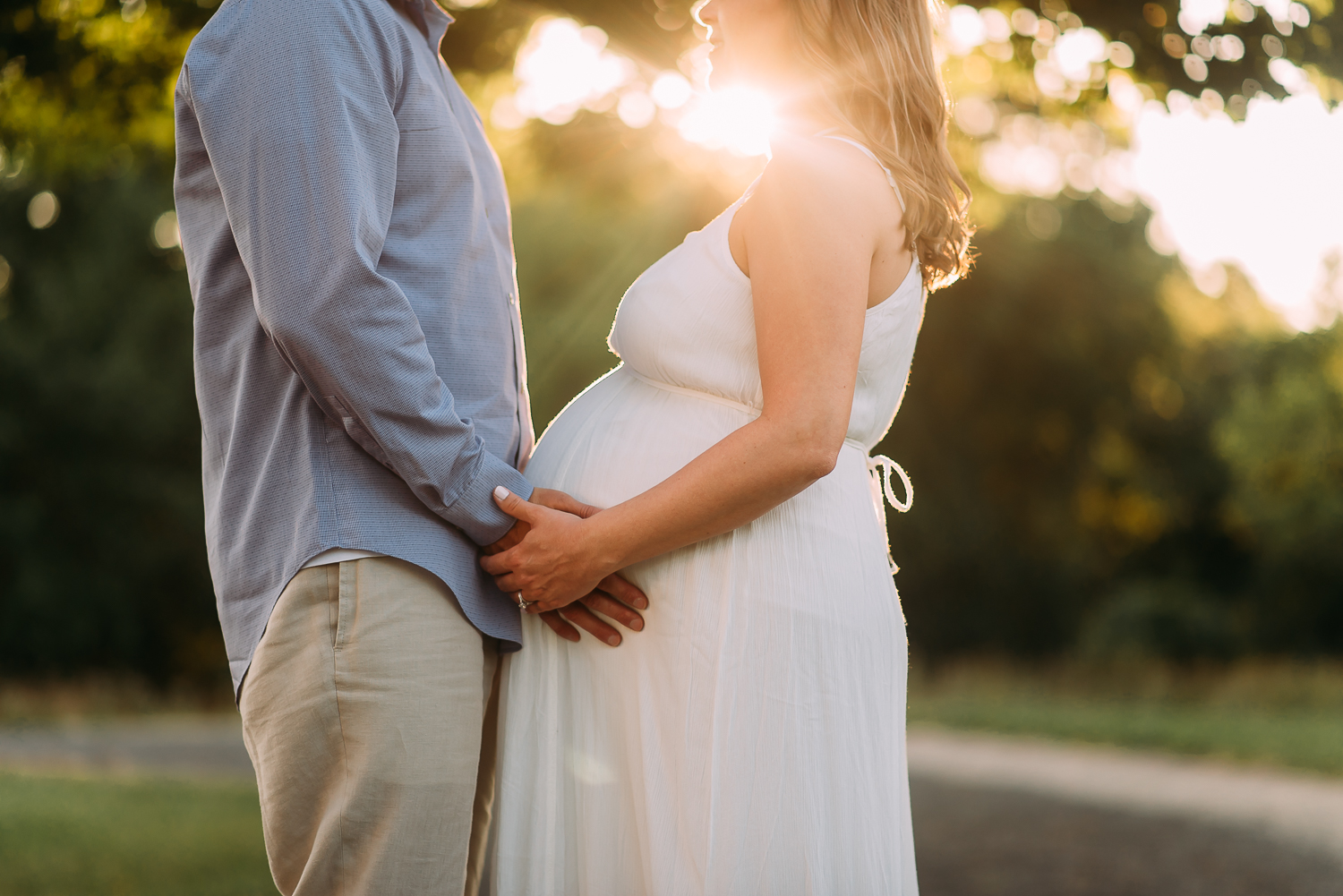 maternity photography pregnant woman with husband bump sunset Baltimore Photographer