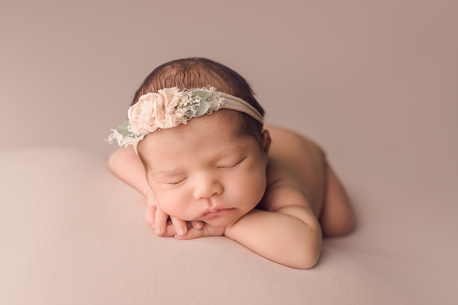 Baltimore Maryland Newborn Photographer Jessica Fenfert baby girl on pink head on hands