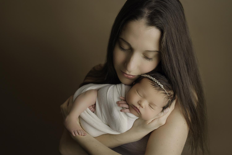 Baltimore Maryland Newborn Photographer Jessica Fenfert baby girl in mom's arms