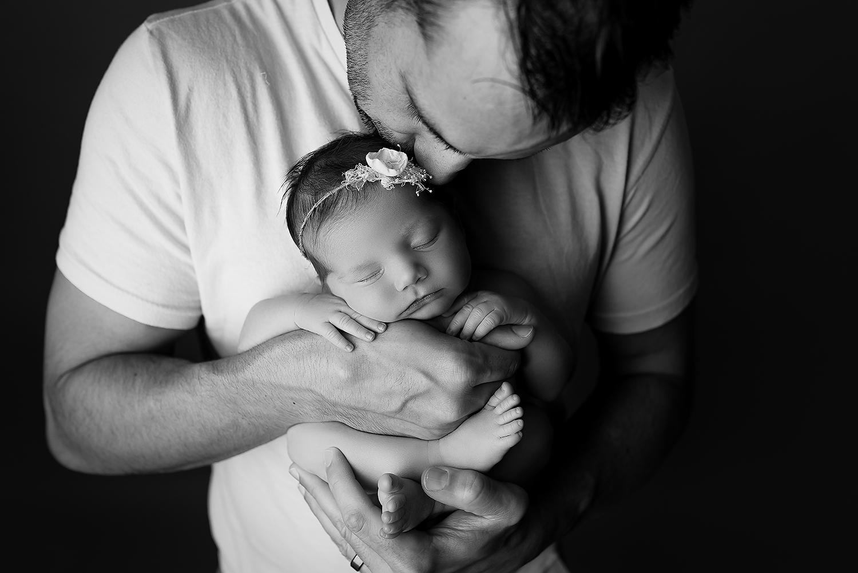 Baltimore Maryland Newborn Photographer Jessica Fenfert baby girl in dads hands