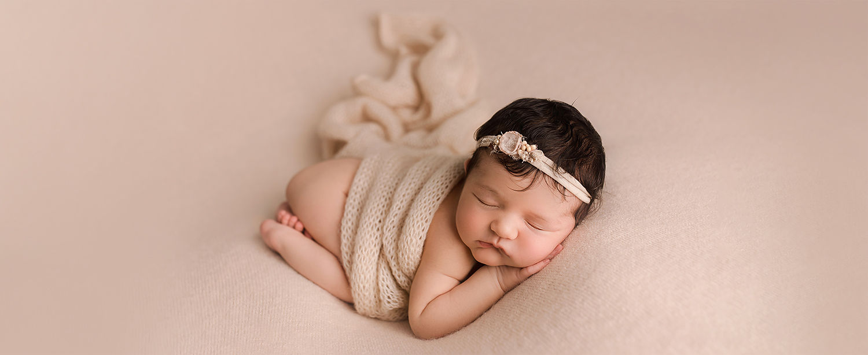 Baltimore Maryland Newborn Photographer Jessica Fenfert baby girl on cream