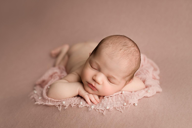 Jessica Fenfert Baltimore Maryland Newborn Photographer head on hands pink