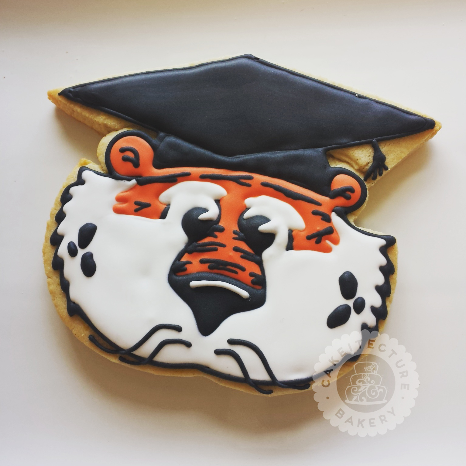 Cakeitecture Bakery Aubie Graduate cookie.jpg