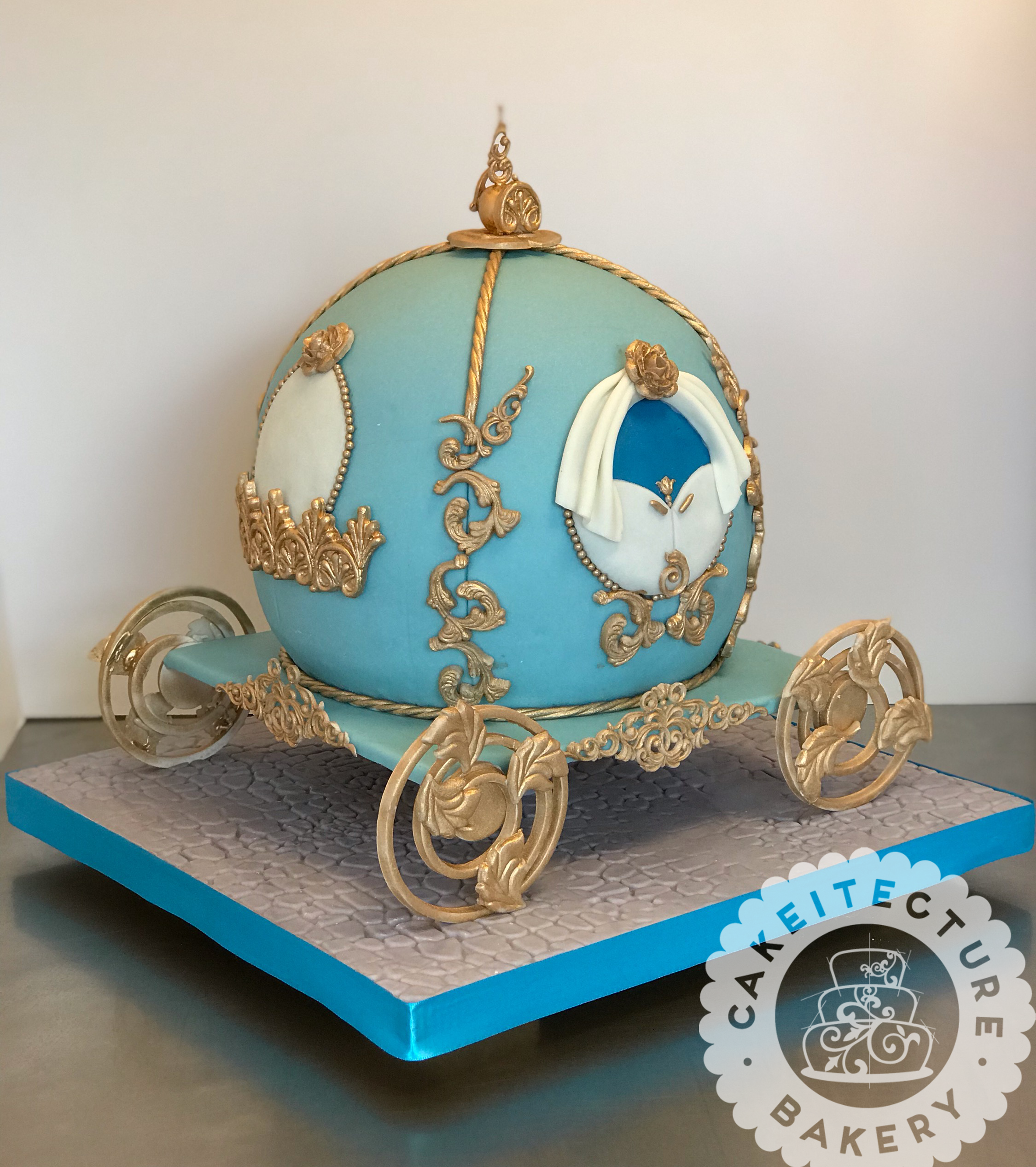 Cakeitecture Bakery Sculpted carriage cake.png