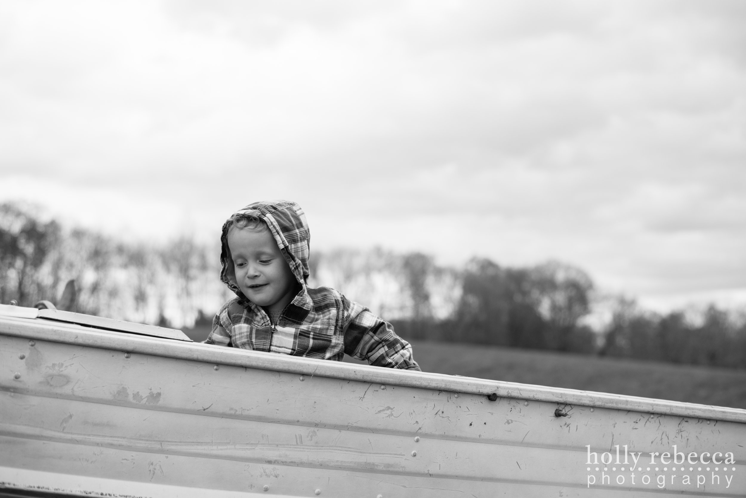 Boy peering over the side of a boat