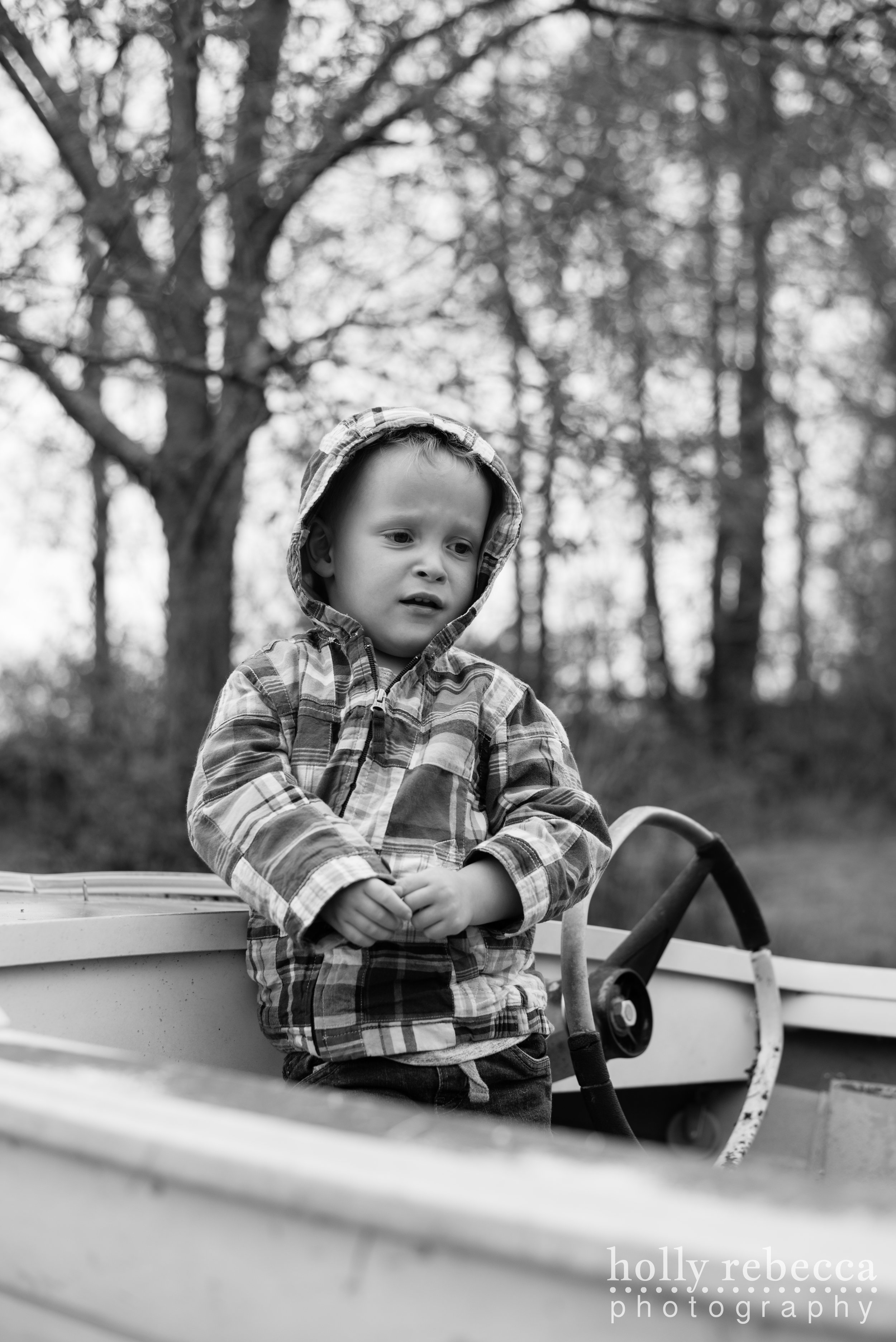 Boy resting by the stern of a boat