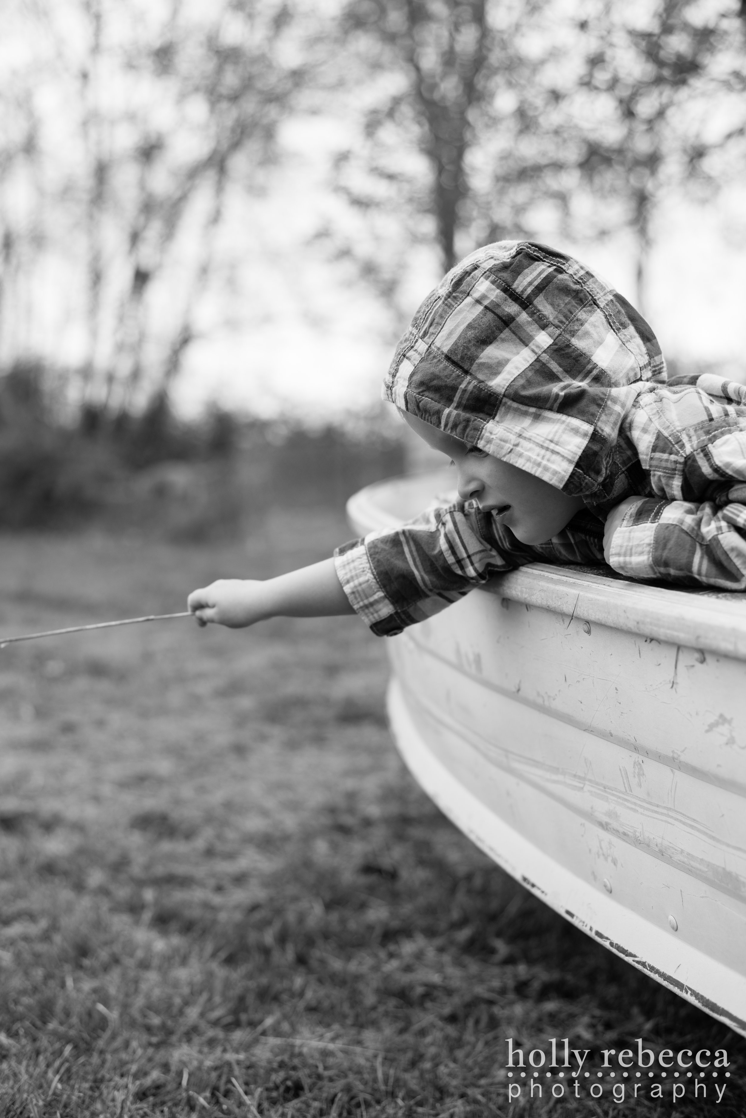 Boy leaning over the side of a boat