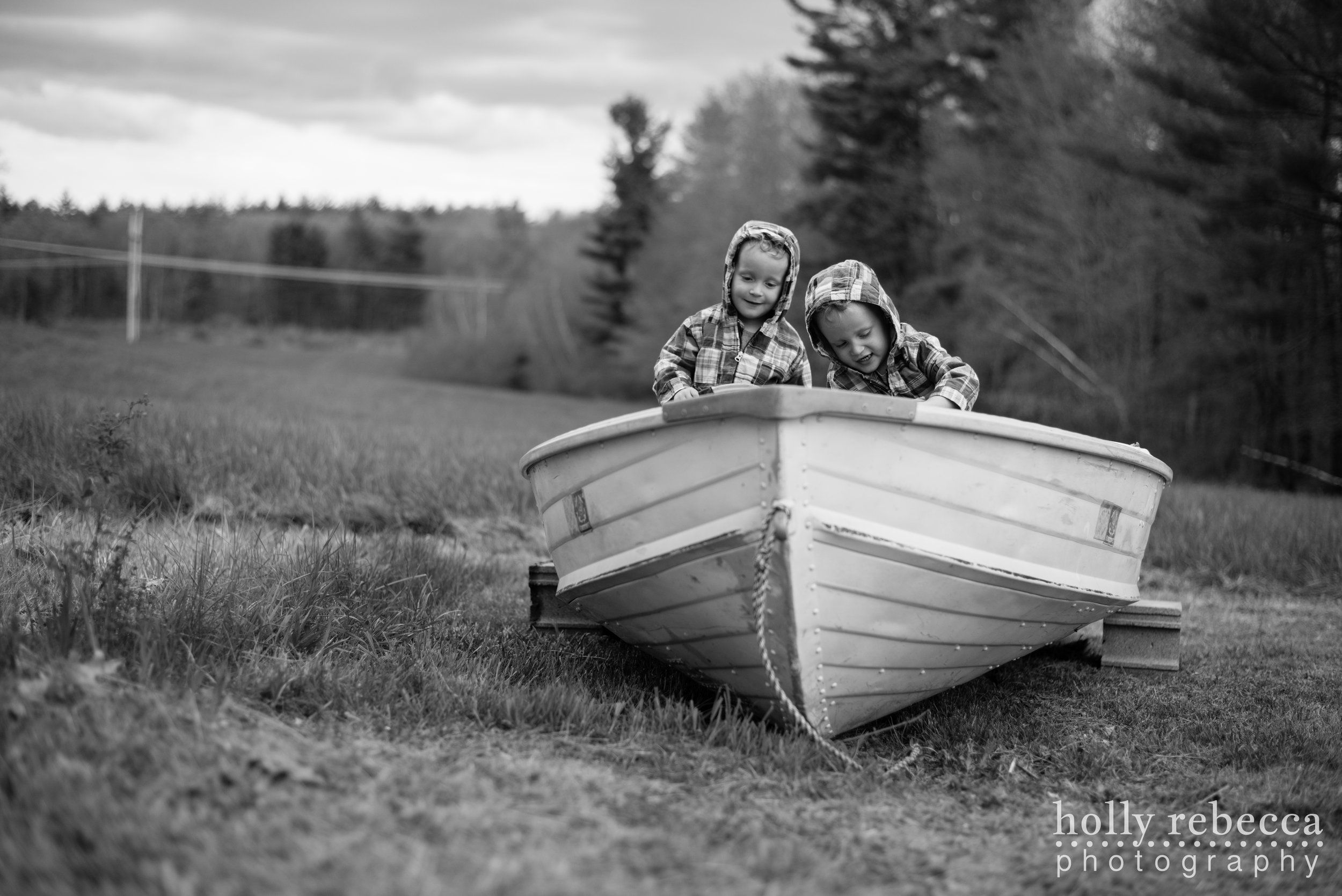 Twin boys playing in a boat by the New Hampshire woods (2)