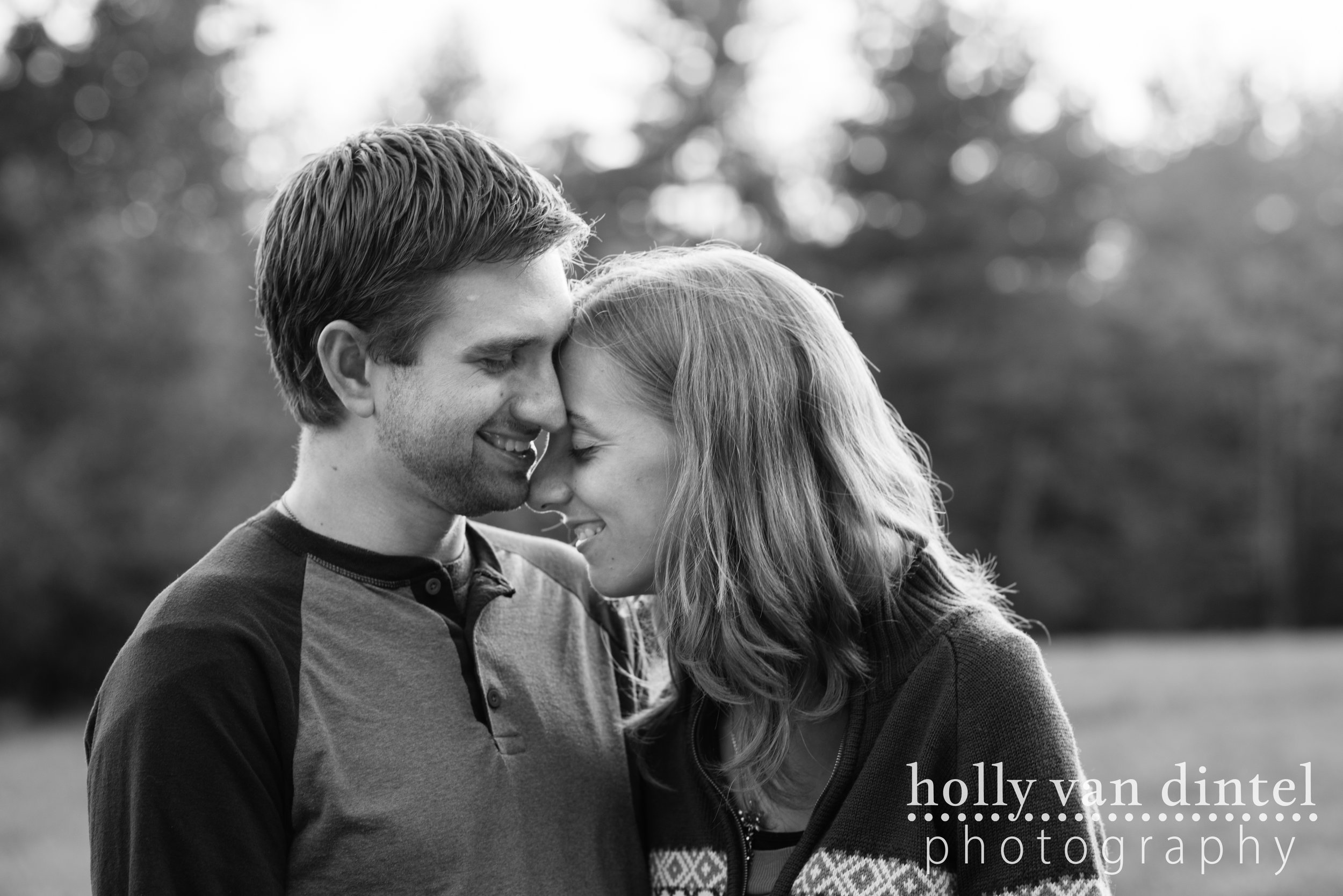 Black and white images of engaged couple, kissing forehead