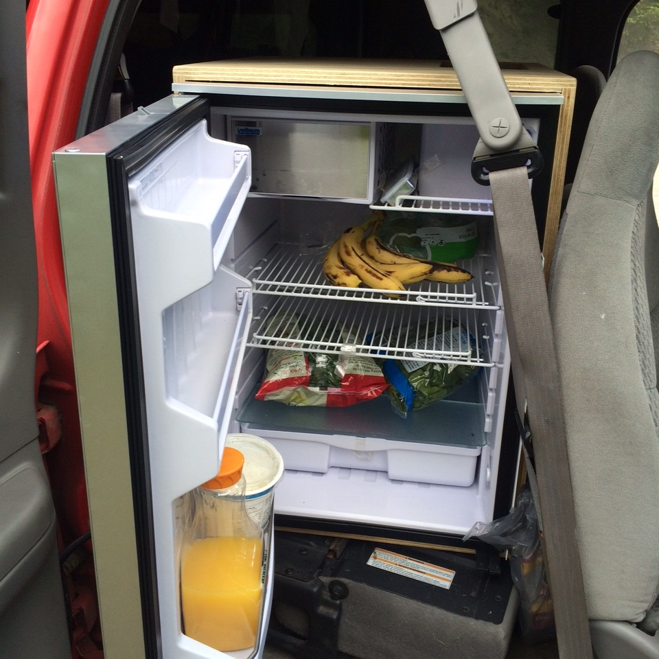 I don't ever have to deal with buying ice or draining a cooler. I have a full-fledged mini fridge behind the front seat. It even has a enclosed freezer.
