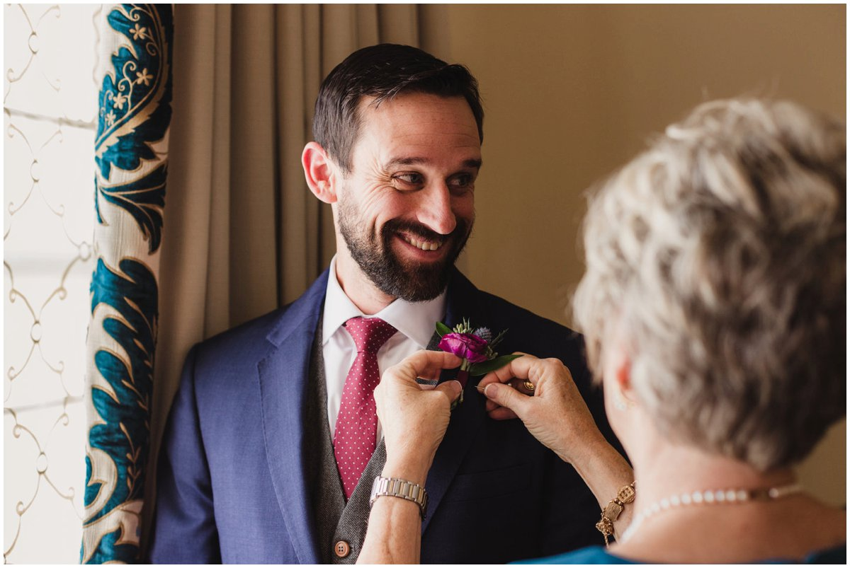 urban-row-photo-groom-with-mom-pinning-boutonniere_0009.jpg