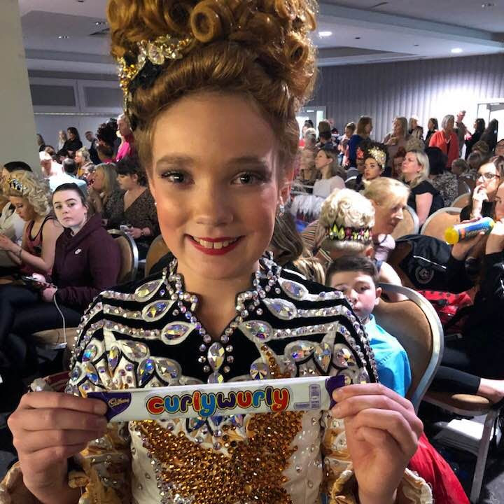 "Anna Kate Celebrating with a ""CurlyWurly"" chocolate bar after her 1st round - a much sought after treat for our dancers :)"