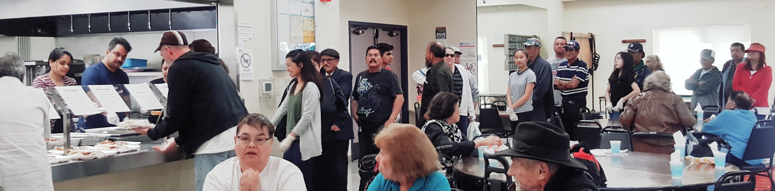 Photo courtesy Anne Santos with Loaves & Fishes People line up for a free meal at Loaves & Fishes meal service site at the Eastside Neighborhood Center on Alum Rock Avenue.
