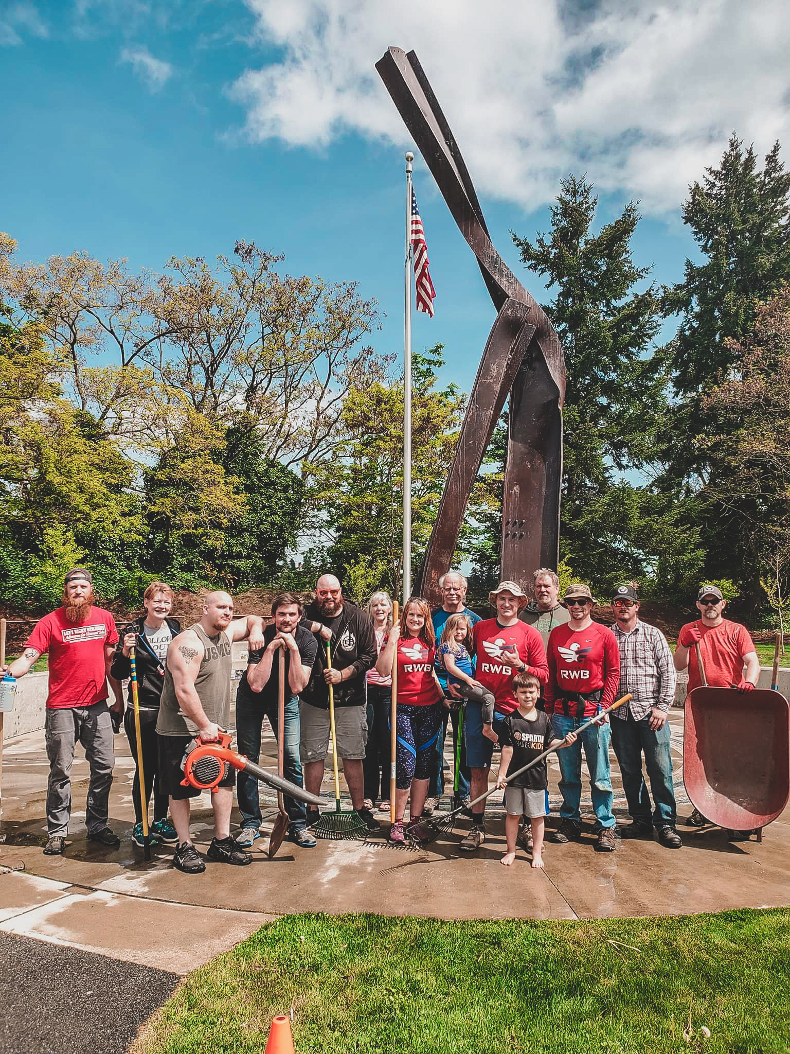 Here we stand next to a couple of the volunteers from the Bremerton VFW Post, some community members, and members of Team RWB Kitsap. It was great to see people from all different parts of our Kitsap community come to help clean up the Memorial site.
